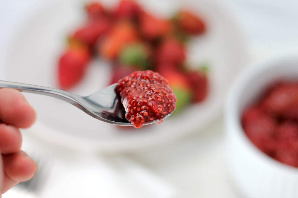 Keto Strawberry Jam is an easy dish to prepare and goes perfectly with everything from breakfast to dessert! Using chia seeds and xylitol, this easy keto recipe is ready in no time. #keto #easyketo #ketogenicrecipes