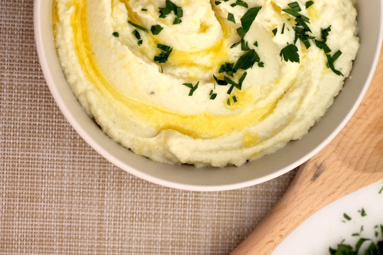 A delicious, creamy and buttery Keto Cauliflower Mash recipe will be your go to Keto side dish for years to come! Using the microwave and a blender, this keto mash recipe is ready in 10 minutes flat. #ketosidedish #ketocauliflower #ketorecipe #keto