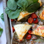 Keto Pesto Chicken Bake with Haloumi recipe by Aussie Keto Queen. Succulent chicken thighs, topped with basil pesto and haloumi and grilled to perfect. A quick family favourite that is no fuss! Serves two small chicken thighs per person.