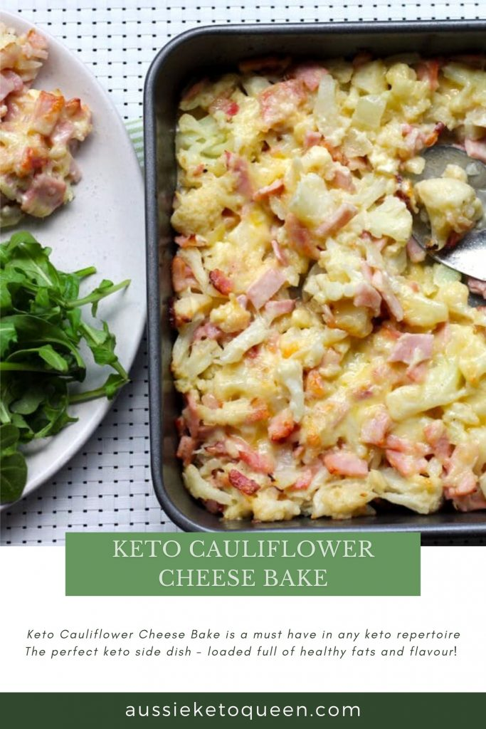 Keto Cauliflower Cheese Bake by Rachel Burke Aussie Keto Queen. Keto Cauliflower Cheese Bake is a must have in any keto repertoire The perfect keto side dish - loaded full of healthy fats and flavour! Keto Cauliflower Cheese Bake on a tray with green leafy vegetable on the side.