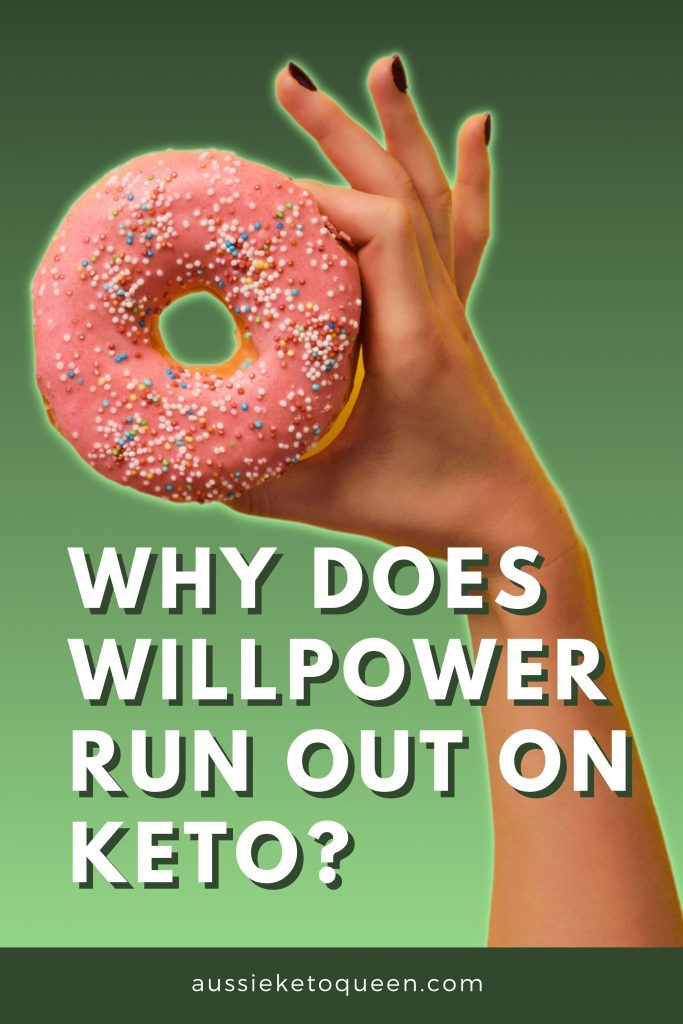 Why Willpower Isn't Enough to Stick With Keto - Plus Strategies To Make It Stick - Why does Willpower run out on Keto? - Hand holding pink donut