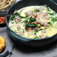 Keto Zuppa Toscana Soup by Aussie Keto Queen. Keto Zuppa Toscana Soup is not your typical soup! It is creamy, hearty, filling and a little spicy. Using Italian sausage brings an amazing depth of flavour and combined with bacon, the broth is so packed with flavour it will knock your socks off. The perfect winter Keto Soup!